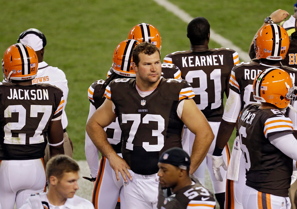 . Cleveland Browns offensive tackle Joe Thomas on the sidelines in the third quarter of a preseason NFL football game against the St. Louis Rams Thursday, Aug. 8, 2013, in Cleveland. (AP Photo/Tony Dejak)