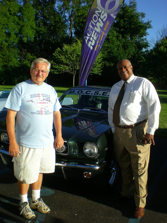 ". Mike Sove of Southfield (left) shows off his 1966 Mustang fastback to Woodward Dream Cruise board member, the Rev. Douglas Jones of Pontiac, at a gathering of the Dream Cruise board Monday at WXYZ-TV in Southfield. Sove, regional director of the Mustang Club of America, will have his car at Nine Mile and Woodward in ""Mustang Alley\"" on Saturday."