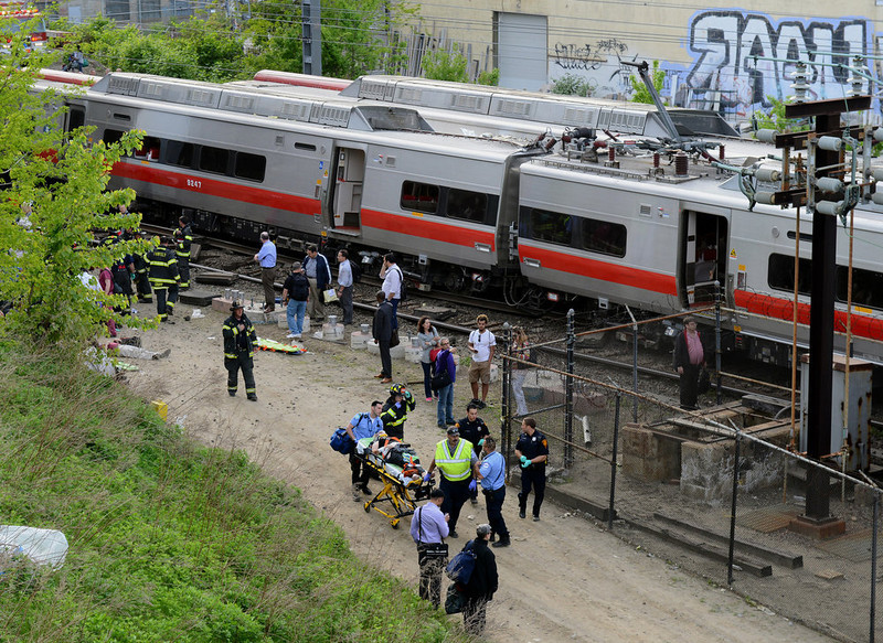 . Injured passengers are removed from the scene of a train collision, Friday, May 17, 2013 in Fairfield, Conn. Two commuter trains serving New York City collided in Connecticut during Friday\'s evening rush hour, injuring about 50 people, authorities said. There were no reports of fatalities. (AP Photo/The Connecticut Post, Christian Abraham)