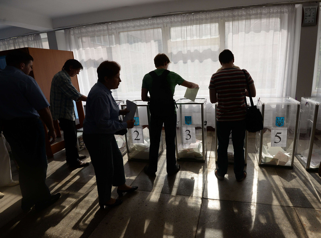 . People cast ballots in the polling station in Kiev on May 25, 2014. Ukraine began voting on Sunday in a presidential election seen as the most important in the country\'s history as it grapples with a deadly pro-Russian rebellion in the east. Thirty-six million people are registered to vote, but the separatist insurgents have threatened to block polling in areas under their control in the industrial east.  ANATOLII BOIKO/AFP/Getty Images