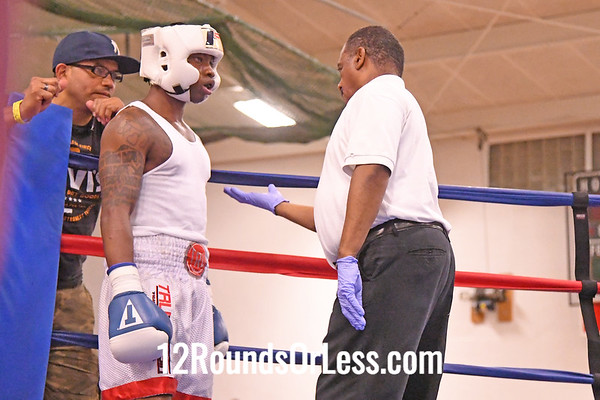 Bout #9:  Armond Richards, Red Gloves, Empire BC, Cleveland -vs- William Flenoy, Blue Gloves, Thurgood Marshall PAL, Cleveland, 141 Lbs