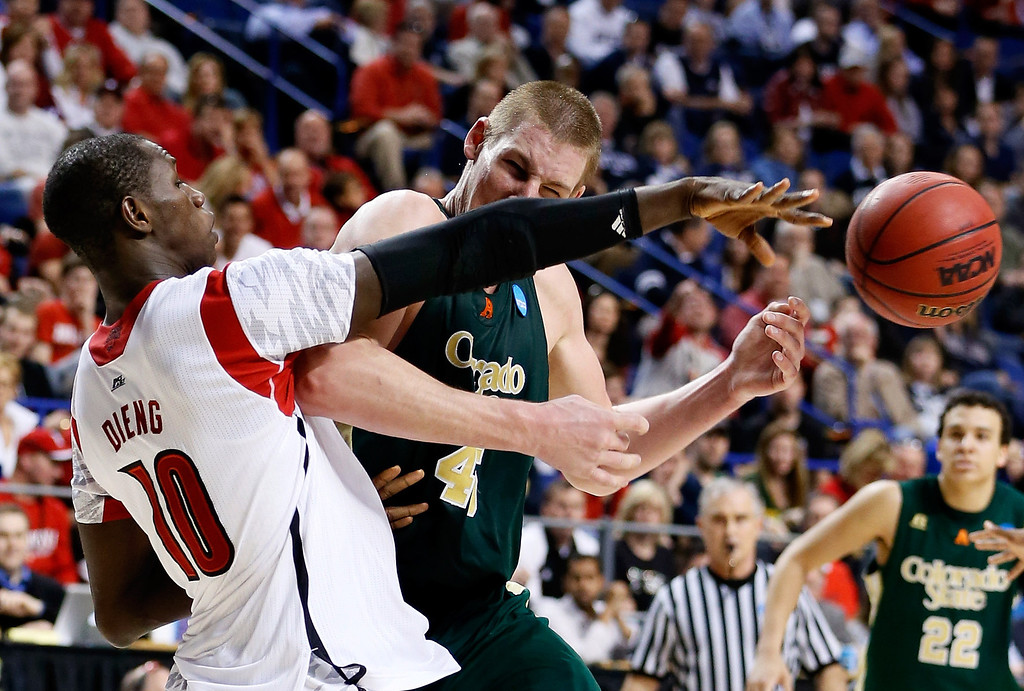 . LEXINGTON, KY - MARCH 23:  Colton Iverson #45 of the Colorado State Rams handles the ball and is fouled by Gorgui Dieng #10 of the Louisville Cardinals in the second half during the third round of the 2013 NCAA Men\'s Basketball Tournament at Rupp Arena on March 23, 2013 in Lexington, Kentucky.  (Photo by Kevin C. Cox/Getty Images)