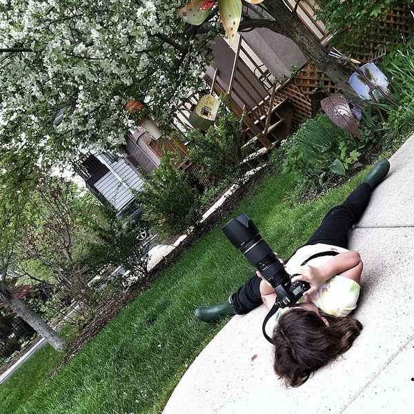 OMG...I so love this girl. For many reasons but not the least of which is she will do anything to get the angle she wants for her flower photos.