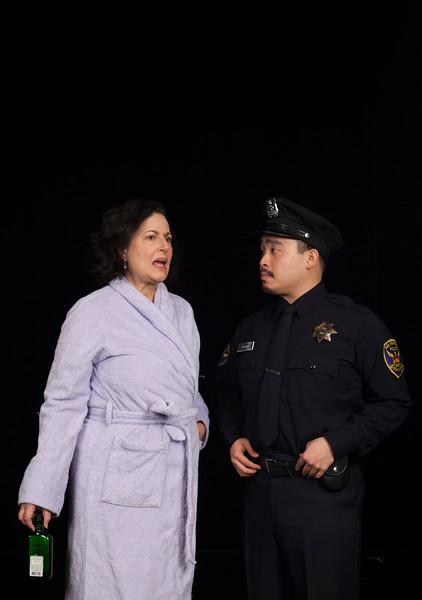 Officer Wong interrogates Lucia. Credit:  L-R: Jeri Lynn Cohen, Phil Wong