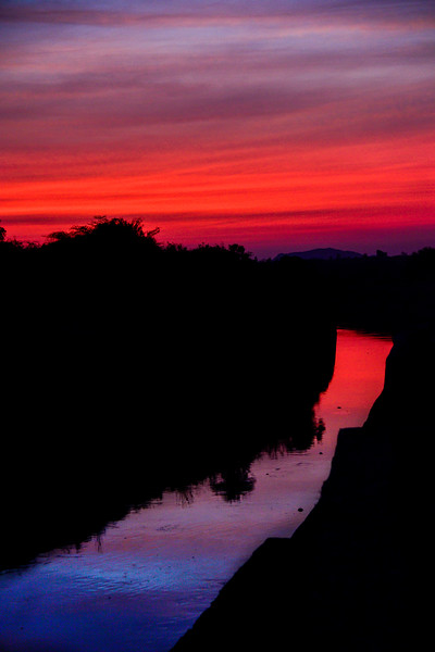 Red-sunset-hampi-kamalapura-canal.jpg