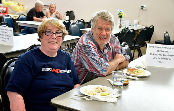 8//8/2019 Mike Orazzi | Staff Linda Donovan and Gary Middleton while at the Meals for Neighbors program at Zion Evangelical Lutheran Church in Bristol.