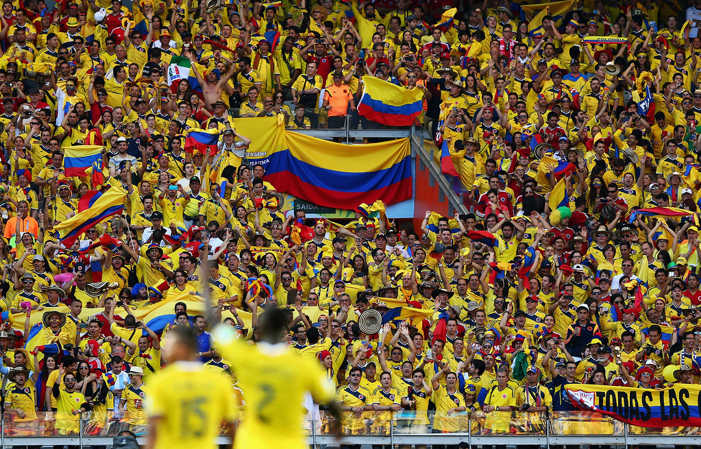 . Fans of Colombia celebate their victory after the 2014 FIFA World Cup Brazil Group C match between Colombia and Greece at Estadio Mineirao on June 14, 2014 in Belo Horizonte, Brazil.  (Photo by Quinn Rooney/Getty Images)