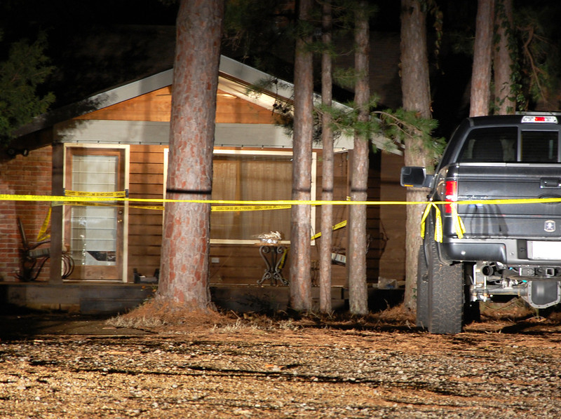 . Yellow crime-scene tape blocks off the front of a home in Heber Springs, Ark., where country singer Mindy McCready was found dead in an apparent suicide on Sunday, Feb. 17, 2013.  She was 37.  (AP Photo/Jeannie Nuss)