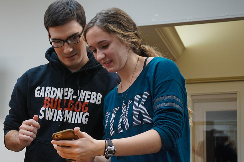 Dalton Meyer and Lauren Denman look at inspiration for their pumpkin-carving.