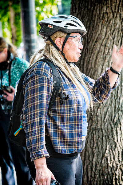 """This woman is the far-right photographer who earlier pepper sprayed the left as she wound through their side under the guise of being a photographer. Apparently it was okay for far-right individuals to enter the counterprotest side to take photos and video but not vice versa, which for obvious reasons did not sit well with the left. To enter the """"Liberty or Death"""" rally you had to be either with the press or a far-right supporter, or a liar. For the first half of the protest I opted to walk around the outside and through the counterprotest side. Once the march around the city blocks began I tagged along with the far-right and entered the rally area to take photos once the march finished."""