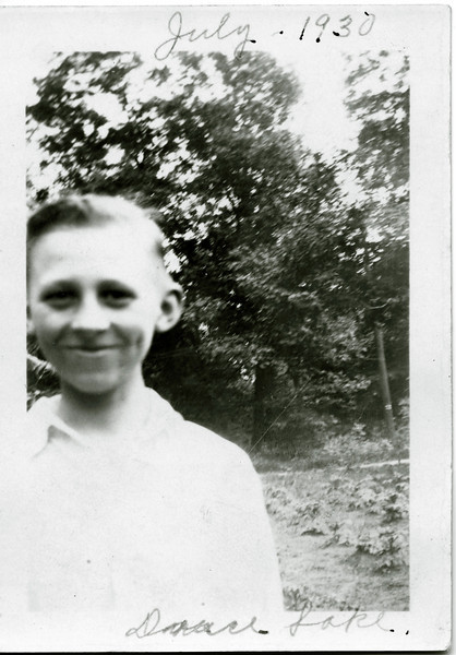 Ed, outdoors and happy. July 1930. Some lake, probably in Wisconsin, which has thousands of them.