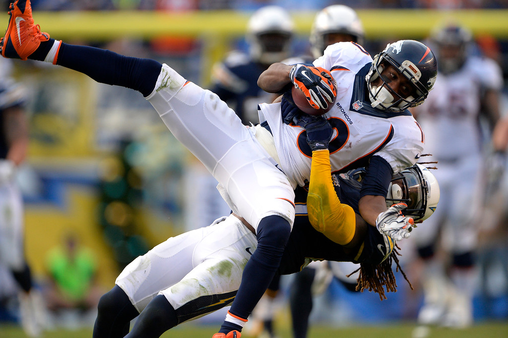 . SAN DIEGO, CA. December 14, - wide receiver Emmanuel Sanders #10 of the Denver Broncos is tackled after a catch in the second half vs the San Diego Chargers at Qualcomm Stadium December 14, 2014 San Diego, CA (Photo By Joe Amon/The Denver Post)