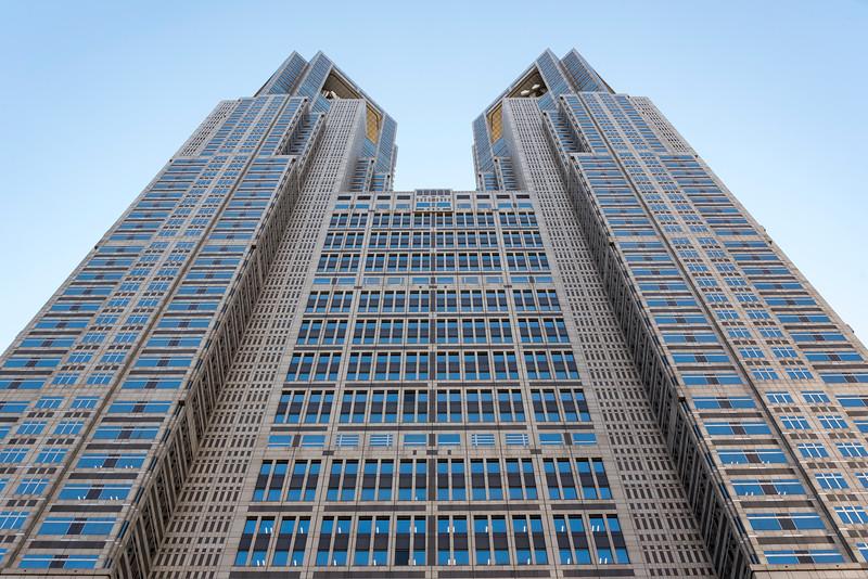 Low-angle view of frontal facade of Tokyo Metropolitan Government Building, Shinjuku, Japan