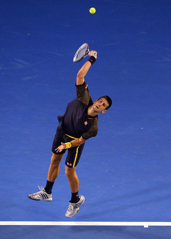 . Serbia\'s Novak Djokovic serves against Britain\'s Andy Murray during the men\'s singles final on day 14 of the Australian Open tennis tournament in Melbourne on January 27, 2013.  WILLIAM WEST/AFP/Getty Images
