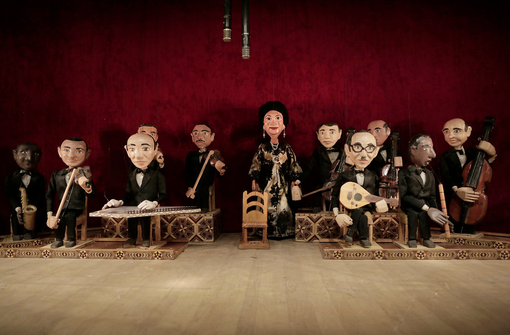 . In this May 3, 2018 photo, marionettes of Umm Kalthoum, the most famed singer of classical Arabic music, and her band, made by Egyptian artist Mohamed Fawzi Bakkar, perform at the El Sawy Cultural Center, in Cairo, Egypt. Bakkar designs and builds marionettes from scratch, hoping to revive a traditional art. The 32-year-old spends hours or even days designing puppets inspired by Egyptian life -- farmers, street vendors, butchers and the occasional celebrity. (AP Photo/Nariman El-Mofty)