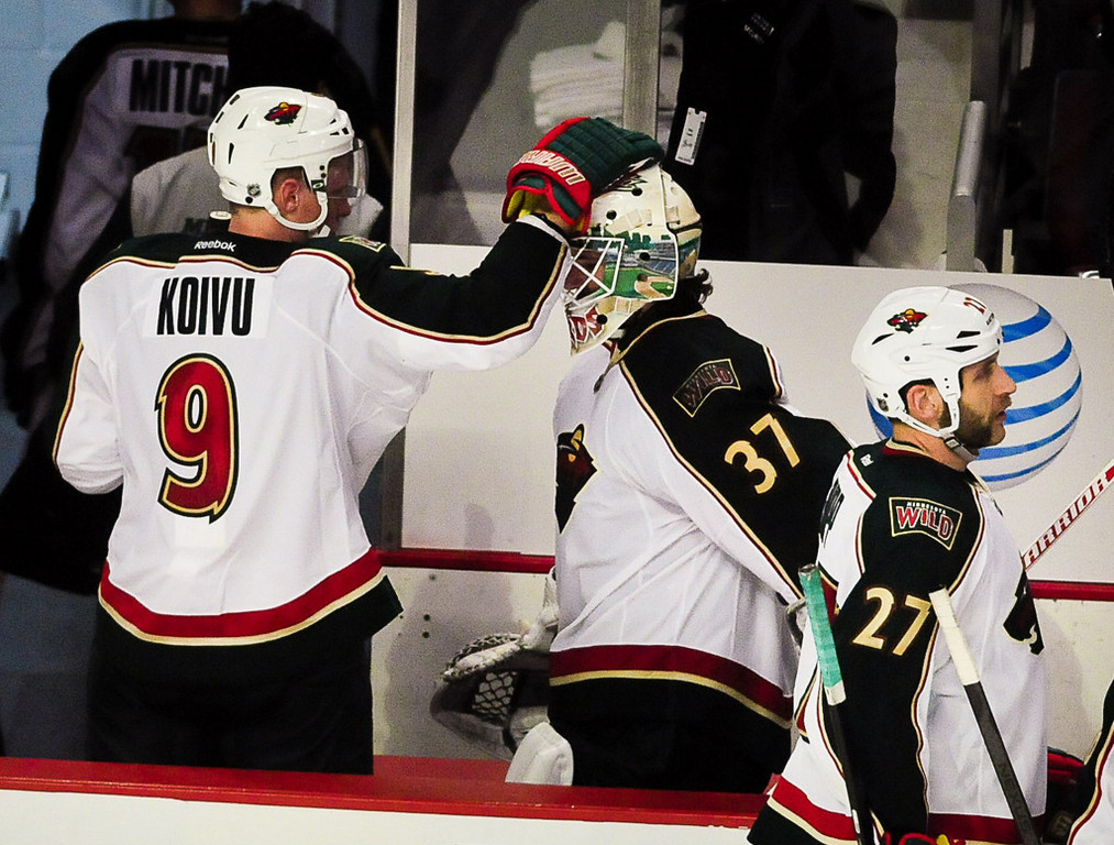 . Minnesota Wild center Mikko Koivu gives goalie Josh Harding a tap after a hard fought game. (Pioneer Press: Ben Garvin)
