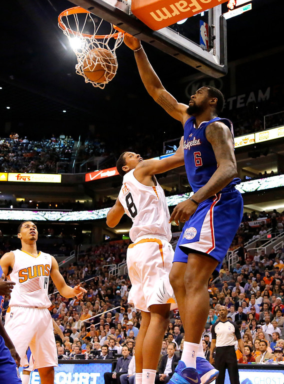 . Los Angeles Clippers center DeAndre Jordan (6) dunks over Phoenix Suns forward Channing Frye (8) during the first half of an NBA basketball game on Wednesday, April 2, 2014, in Phoenix. (AP Photo/Matt York)