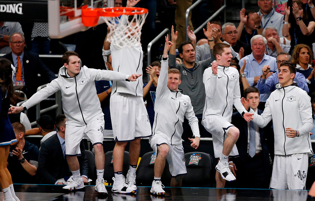 . Players on Villanova bench react to a 3-point basket during the second half in the championship game of the Final Four NCAA college basketball tournament against Michigan, Monday, April 2, 2018, in San Antonio. (AP Photo/Brynn Anderson)