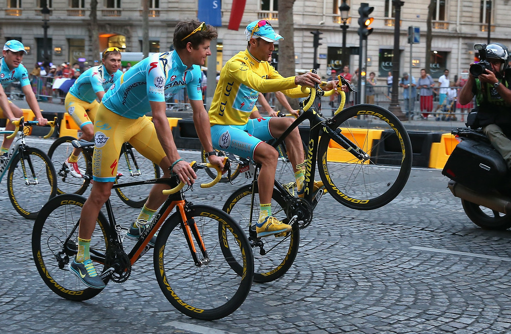 . Vincenzo Nibali of Italy and Astana Pro Team performs a wheelie to celebrate his victory following the twenty first stage of the 2014 Tour de France, a 138km stage from Evry into the Champs-Elysees, on July 27, 2014 in Paris, France.  (Photo by Doug Pensinger/Getty Images)