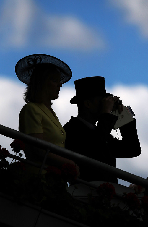 . Silhouettes of Racegoers on day two of Royal Ascot at Ascot Racecourse on June 18, 2014 in Ascot, England. (Photo by Steve Bardens/Getty Images)