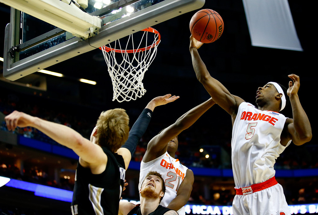 . BUFFALO, NY - MARCH 20: C.J. Fair #5 of the Syracuse Orange grabs a rebound against the Western Michigan Broncos during the second round of the 2014 NCAA Men\'s Basketball Tournament at the First Niagara Center on March 20, 2014 in Buffalo, New York.  (Photo by Jared Wickerham/Getty Images)