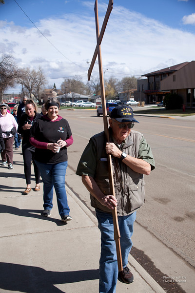 Havre Daily News/Floyd BrandtCarrying the cross down 5th Avenue in Havre on Friday marks Good Friday. Leading a large group of believers for the last time retiring Pastor John Chapman begins the trek from the Lutheran Church to 5th Avenue Church with the cross resting on his shoulder.