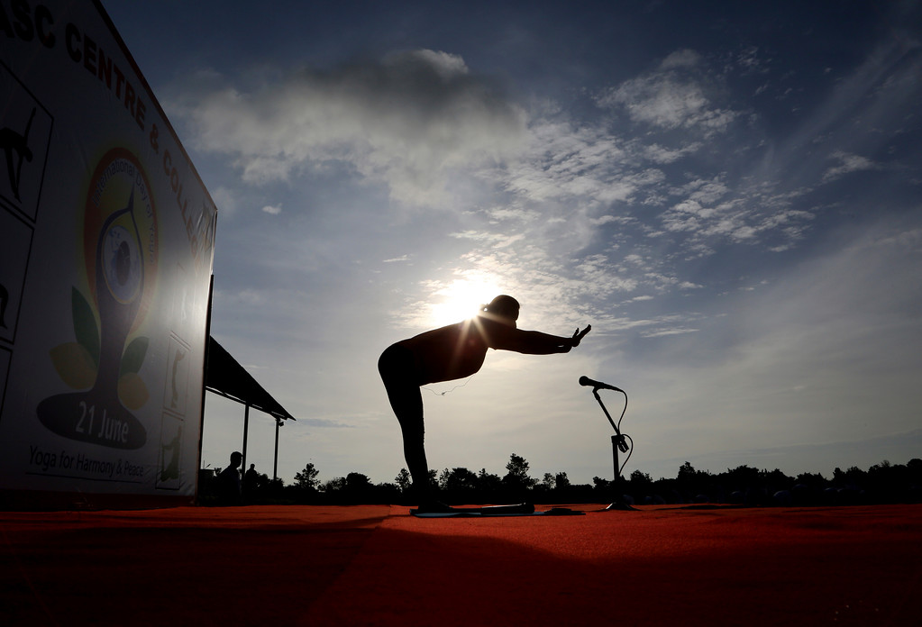 . An Indian yoga instructor leads a large group of Indian army soldiers at a yoga session to mark International Yoga Day in Bangalore, India, Wednesday, June 21, 2017. Yoga practitioners took a relaxing break to bend, twist and pose Wednesday morning for the annual event celebrating the practice, especially in the country where it began. (AP Photo/Aijaz Rahi)