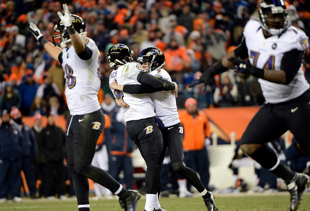 Description of . Baltimore Ravens kicker Justin Tucker (9) celebrates the winning field goal with Baltimore Ravens punter Sam Koch (4).  The Baltimore Ravens beat the Denver Broncos 38 to 35.  The Denver Broncos vs Baltimore Ravens AFC Divisional playoff game at Sports Authority Field Saturday January 12, 2013. (Photo by Hyoung Chang,/The Denver Post)