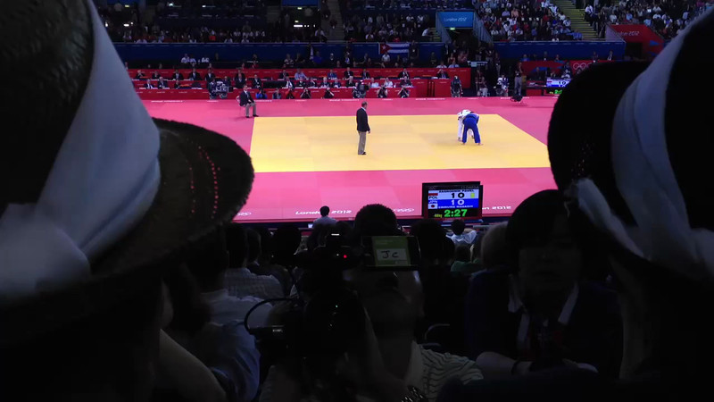 Masashi Ebinuma of Japan in blue, his mother in the dark hat. Countrymen film their reactions during the match