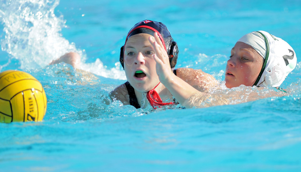 . 02-16-2012--(LANG Staff Photo by Sean Hiller)- Palos Verdes girls water polo defeated Upland 10-8 in Saturday\'s CIF Southern Section Division III quarterfinal at Palos Verdes High School. PV\'s Kirsten Gargas, left, battles Upland\'s Alison Ford.