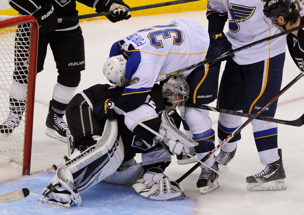 . St. Louis Blues Chris Porter falls on Kings\' goalkeeper Jonathan Quick in the second period, Monday, May 6, 2013, at Staples Center. (Michael Owen Baker/Staff Photographer)