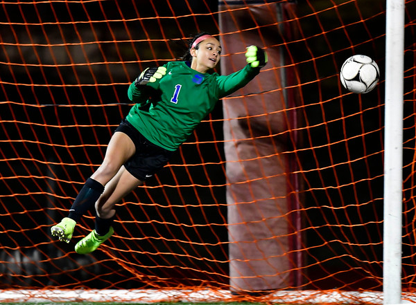 11/19/2019 Mike Orazzi | Staff Southington High School's Emily Eigo (1) makes a save as time expires during the Class LL Semifinal Girls Soccer match at Naugatuck High School with Ridgefield Tuesday night. Southington advanced to the final 1-0.