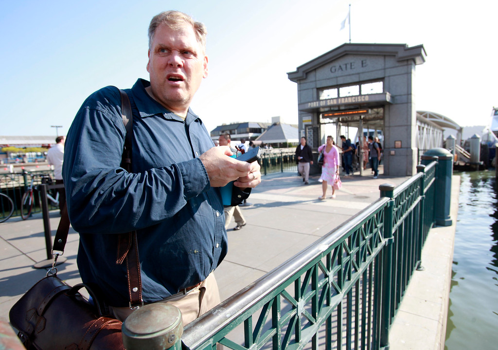 . Bay Area News Group reporter Thomas Peele debarks the Oakland Ferry, two and one-half hours after leaving the Fremont BART station in a race with colleague car-driving Josh Richman who bet him he could beat Peele\'s public transit strategy to Market and Montgomery streets in San Francisco faster Monday morning, July 1, 2013, the first day of the BART strike.  (Karl Mondon/Bay Area News Group)