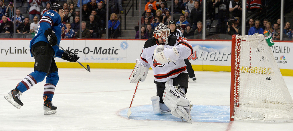 . DENVER, CO - JANUARY 16: Colorado Avalanche center Ryan O\'Reilly (90) scores the game winner on  New Jersey Devils goalie Cory Schneider (35) during a shootout January 16, 2014 at Pepsi Center. Colorado Avalanche defeat the New Jersey Devils 2-1 in the shootout. (Photo by John Leyba/The Denver Post)