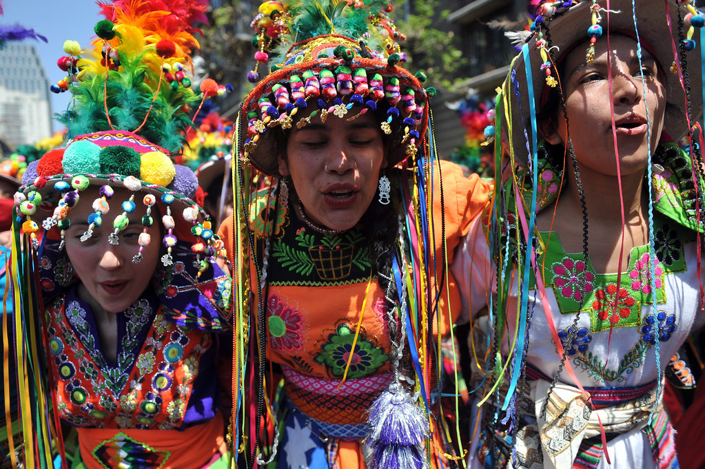 . Women perform the Tinku ritual dance during a protest of Mapuche indigenous people for the commemoration of Columbus Day in downtown Santiago, on October 12, 2013. HECTOR RETAMAL/AFP/Getty Images