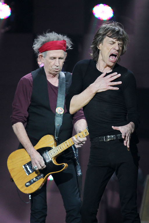. This image released by Starpix shows Keith Richards, left, and Mick Jagger of The Rolling Stones performing at the 12-12-12 The Concert for Sandy Relief at Madison Square Garden in New York on Wednesday, Dec. 12, 2012. Proceeds from the show will be distributed through the Robin Hood Foundation. (AP Photo/Starpix, Dave Allocca)