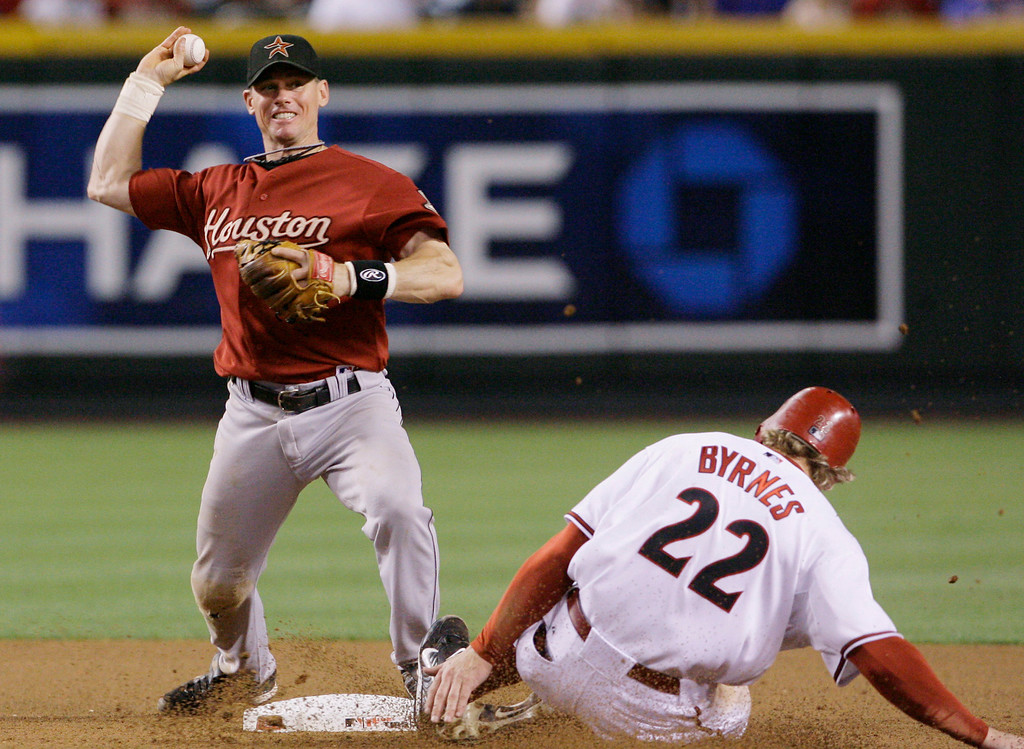 . CRAIG BIGGIO -- Houston Astros\' Craig Biggio, left, forces Arizona Diamondbacks\' Eric Byrnes out at second base to start a double play during the seventh inning on May 24, 2007, in Phoenix.  (AP Photo/Ross D. Franklin)