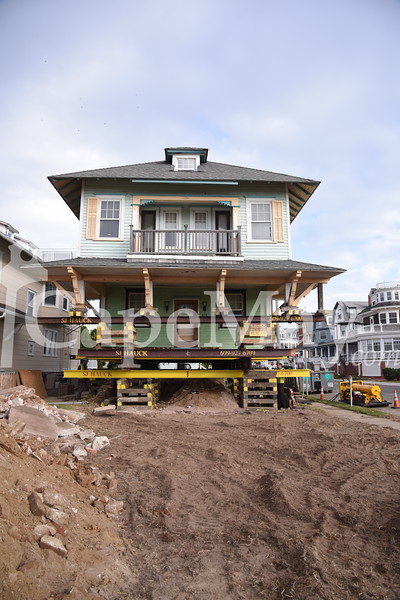 825 Beach Ave House w/ Dogs being lifted