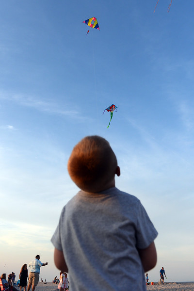 4 year old Drew Pollo controls his kite at the Kites and Castles event on Lavallette Beach, in Lavallette, NJ on 08/01/2019.