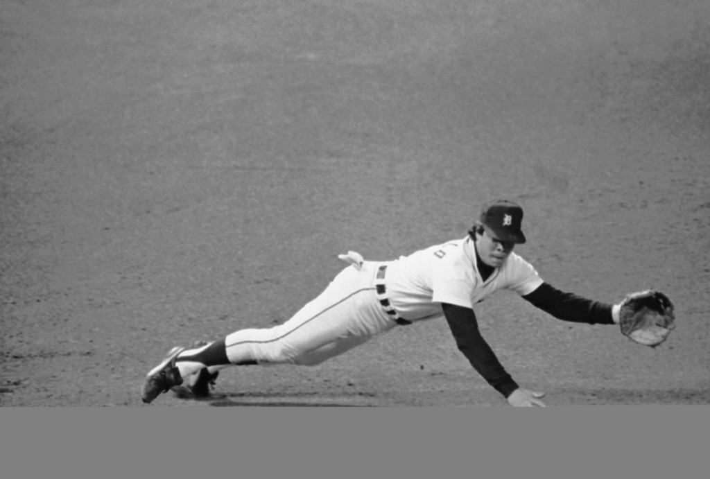 . Marty Castillo, Detroit third baseman, dives, but cant get a grounder by Carmelo Martinez of San Diego in the fifth inning of World Series game at Tiger Stadium, Friday, Oct. 13, 1984, Detroit, Mich. (AP Photo/Lenny Ignelzi)
