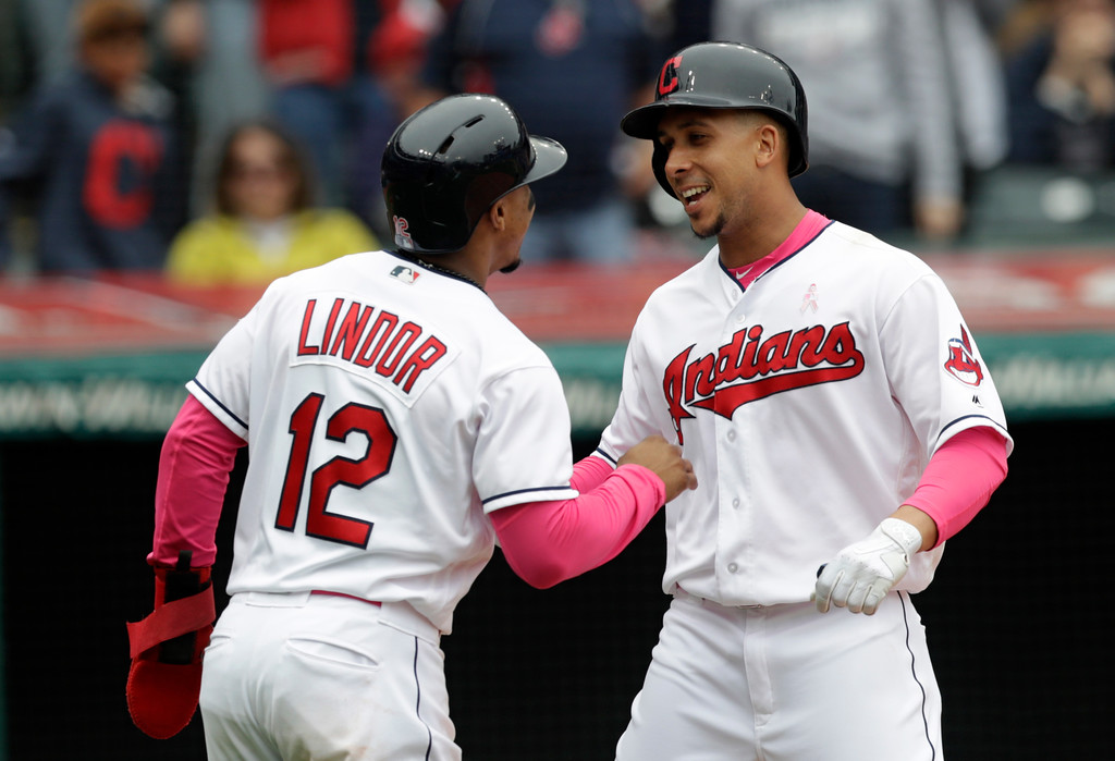 . Cleveland Indians\' Michael Brantley, right, is congratulated by Francisco Lindor after hitting a two-run home run in the seventh inning of a baseball game against the Kansas City Royals, Sunday, May 13, 2018, in Cleveland. (AP Photo/Tony Dejak)