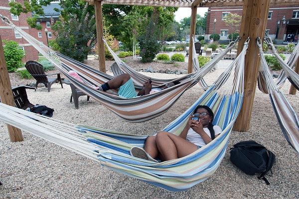 08/28/18 Wesley Bunnell | Staff CCSU Freshman Khalid Payne, L, and Tamara Alexander enjoy the hammocks on campus on the first day of school for the fall semester on Tuesday afternoon.