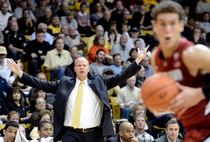 . University of Colorado Head Coach Tad Boyle signals to his team as Dwight Powell, at right, drives towards the hoop during a game against Stanford on Thursday, Jan. 24, at the Coors Event Center on the CU campus in Boulder. Jeremy Papasso/ Camera