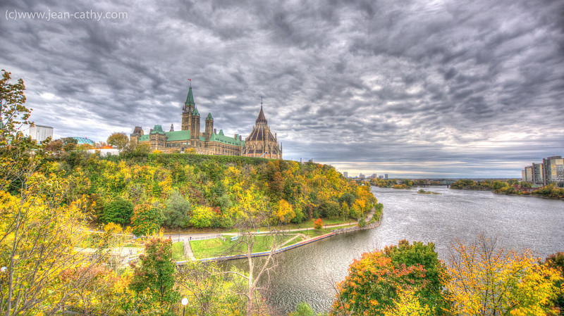 Parliament Hill & the Parliamentary Library along the Ottawa river, Ottawa, Ontario (Canada).