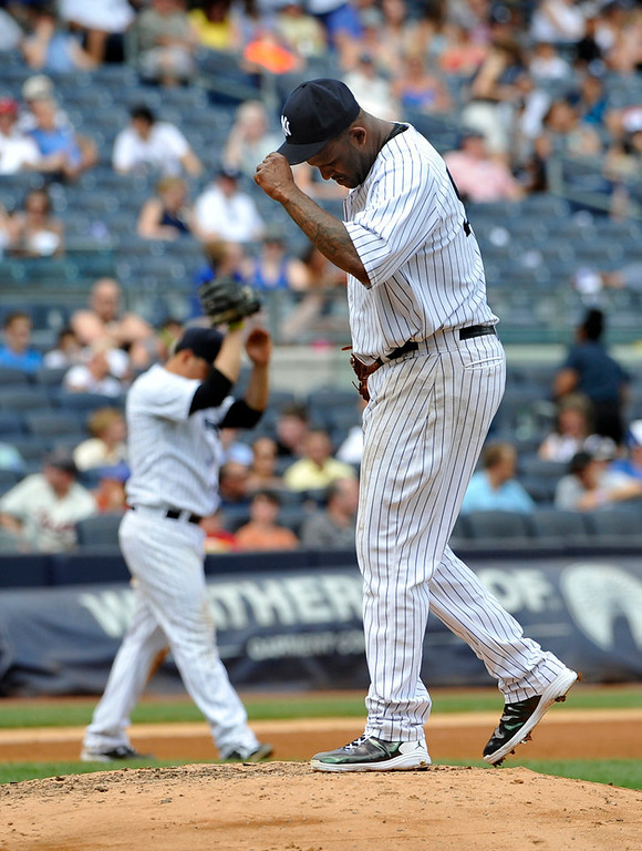 . Yankees starting pitcher C.C. Sabathia pauses on the mound after he loaded the bases by walking Minnesota\'s Joe Mauer in the fourth inning. (AP Photo/Kathy Kmonicek)