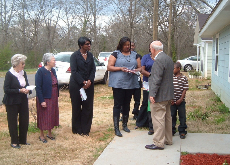 10 03-28   Bill Scott presents Bible to Shenona Williams  kr