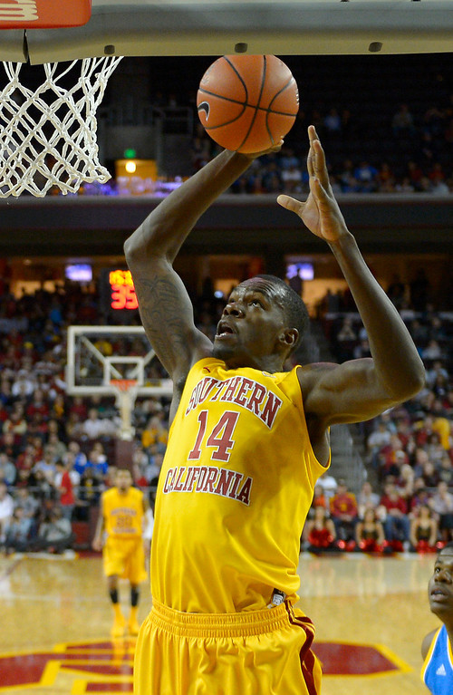 . <b>Dewayne Dedmon</b> <br />Center, 7-0, 255. Averaged 6.7 points, 7.0 rebounds and 2.1 blocks as a junior last year as USC. Was a surprise early entry. Late bloomer from Lancaster has athleticism, but his offensive skills are limited. Could be a project or could go undrafted. (AP Photo/Mark J. Terrill)