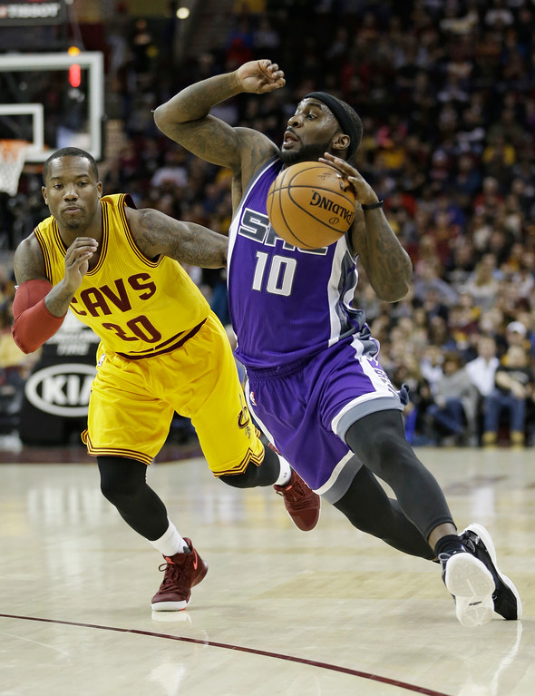 . Sacramento Kings\' Ty Lawson (10) drives against Cleveland Cavaliers\' Kay Felder (20) during the first half of an NBA basketball game, Wednesday, Jan. 25, 2017, in Cleveland. (AP Photo/Tony Dejak)