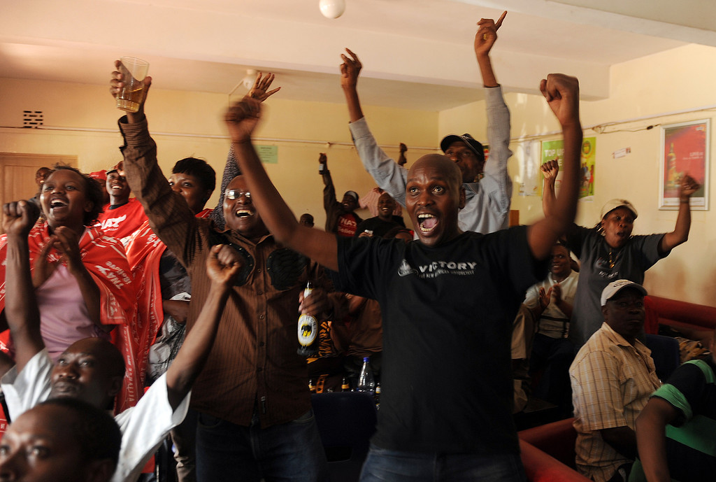 . Supporters of Kenyan presidential candidate Uhuru Kenyatta watch TV and celebrate after the announcement of his victory in Kenya\'s national elections on March 9, 2013 in Kiambu.  AFP PHOTO / SIMON MAINA/AFP/Getty Images
