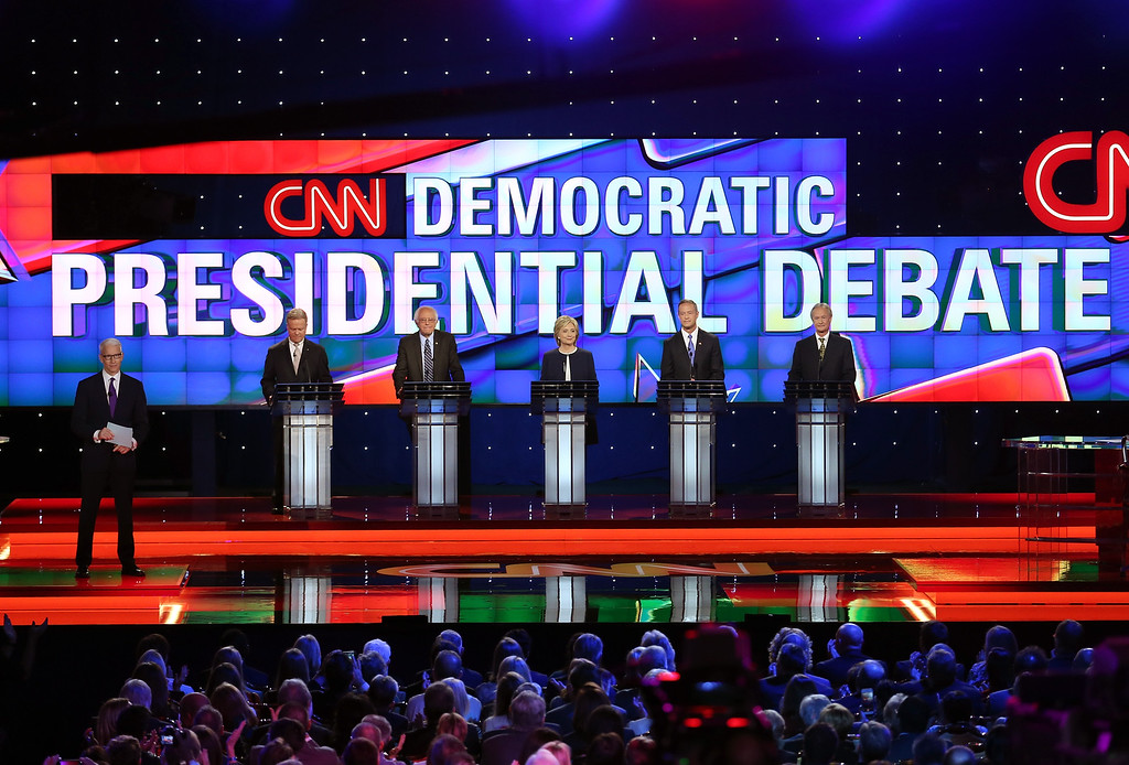 . LAS VEGAS, NV - OCTOBER 13:  (L-R) CNN anchor Anderson Cooper moderates a presidential debate sponsored by CNN and Facebook for Democratic presidential candidates Jim Webb, U.S. Sen. Bernie Sanders (I-VT), Hillary Clinton, Martin O\'Malley and Lincoln Chafee at Wynn Las Vegas on October 13, 2015 in Las Vegas, Nevada. The five candidates are participating in the party\'s first presidential debate.  (Photo by Joe Raedle/Getty Images)